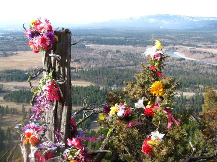 Dedication or memorial.  Flathead River and Big Mountain in background.
