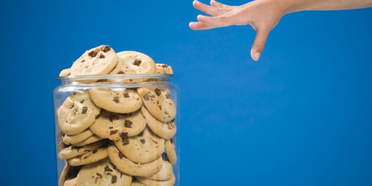 Hand reaching for chocolate chip cookie jar
