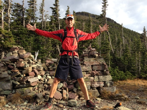 Neal with one foot in the east, and one in the west. Continental Divide, Swiftcurrent Pass, Glacier NP.
