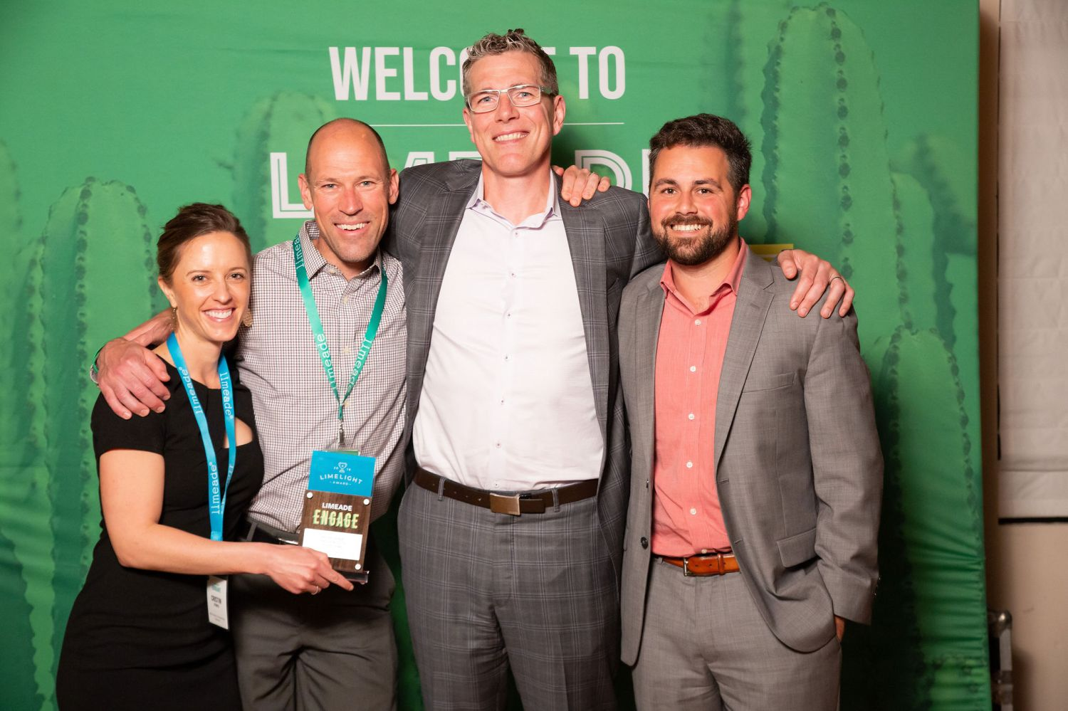 Cristin and Neal with Henry Albrecht, CEO of Limeade, and Joe Decker, our Limeade Account Manager.